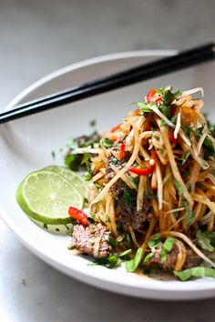 Vietnamese Beef Salad with Papaya - 1 lb beef (tenderloin, tri tip or flank steak); 2-3 Cups shredded Green Papaya ( or rice noodles); 1 Cup combo of fresh mint, cilantro and basil; 2 T roasted crushed peanuts; 1 T fried shallots. Dressing: 2 T fresh lime juice; 1 T plus 1 tsp olive oil; 1 T plus 1 tsp sugar; 2 tsp fish sauce; 2 tsp mild red chili- finely sliced; 1 finely minced garlic clove