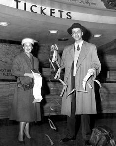 Mr. and Mrs. W.G. (Bill) Clayton of Grand Island, Nebraska, with 10 feet of tickets after they traveled around the world in 79 days in 1958. THE WORLD-HERALD