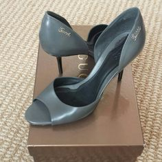 """Authentic Gucci grey d'orsay heels Gucci d'orsay heels in elephant gray. Actual heel is black patent and very narrow. Silver """"gucci"""" script label on the outside of both heels. In great condition but heel tips need to be replaced. Gucci Shoes Heels"""