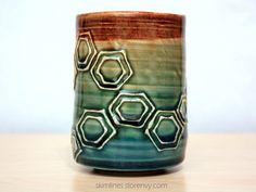 skimlines:  This tea cup has a slip-trail turtle shell motif...