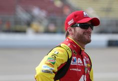Dale Earnhardt Jr. Photos - Dale Earnhardt Jr, driver of the #88 Axalta Chevrolet, sits on the grid during qualifying for the NASCAR Sprint Cup Series FireKeepers Casino 400 at Michigan International Speedway on June 10, 2016 in Brooklyn, Michigan. - Michigan International Speedway - Day 1