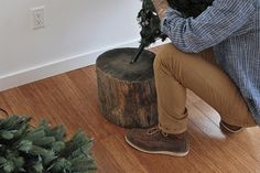 drill a hole in a log to make a base for your fake tree that looks real