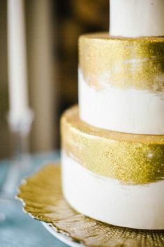 We love this modern wedding cake decorated with edible gold leaf paint.