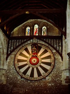 According to legend, the Round Table which hangs in the Great Hall of Winchester Castle is the table around which King Arthur and his Knights met, and it has been famous for centuries for its associations with the legendary 'Once and Future King'. Although we now know that it originated many centuries later, the table's mystique still remains.  It was probably created in about 1290.  In the early years of King Henry VIII's reign the table was painted with the Tudor Rose at its center