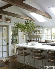 Wood Floors and white kitchen