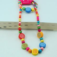 Childrens  multicolour bead necklace and bracelet from jowel by DaWanda.com