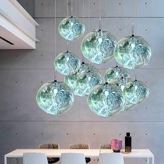 The Orb Pendant Light, a shimmering beacon waiting to be hung from any ceiling. Try it in your kitchen, your restaurant or anywhere else, its appeal is far reaching! Details: Bulb type: Material: Glass Voltage: 90 - 240 V Available in 3 sizes Orb Pendant Light, Cheap Pendant Lights, Modern Pendant Light, Pendant Lamp, Blown Glass Pendant Light, Glass Chandelier, Modern Chandelier, Chandelier Lighting, Modern Lighting
