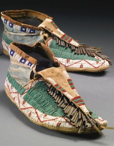 Pair of Sioux Beaded and Painted Hide Man's Moccasins | lot | Sotheby's