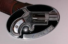 I remember a few years back seeing a belt buckle gun. It was a PD lecture on frisking, and where weapons have been found hidden. The instructor took off his belt, and showed us a 1 shot .22 secured on the backside of buckle.    Here's another version, this is actually a functioning revolver made to look like a belt buckle.