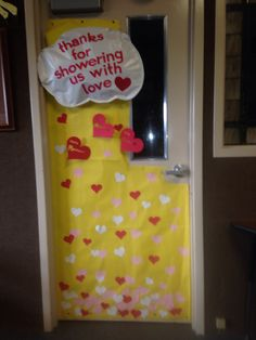 Teacher Appreciation Day door -- Thanks for showering us with love. Cloud stitched and stuffed....3D hearts with teacher names on strings from cloud, heart raindrops