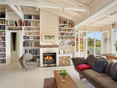 Beautiful lounge. Exposed beams, bookshelves, fireplace. Love it!