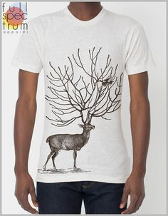 """Light and durable. Our Men's shirt are fitted for that throwback retro """"snug"""" but not feel. Here A deer's antlers have begun to fancy tree branches, and now birds are beginning to flock!"""