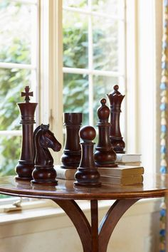 Large chess pieces used as paper weights.