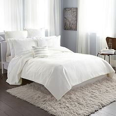 SALE   The exquisite DKNY City Line Duvet Cover is ultra sophisticated modern bedding. Beautiful tonal ivory paired with a patterned jacquard creates a look that conveys rich texture and detail with a subtlety and elegance that will transform your bedroom.