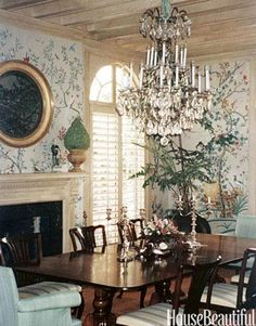 Michael Taylor's Style:     The dining room designed by Michael Taylor features wallpaper that is a copy of an 18th-century chinoiserie original. Taylor had the baseboards faux-grained and waxed to look like pale oak.