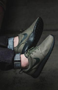 Black and olive green Roshe Runs paired with cuffed raw denim.