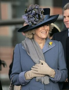 Camilla wearing a gorgeous hat and looking great in this outfit...