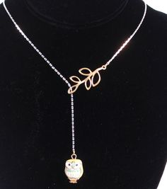 This owl and branch drop necklace is such a cute idea!