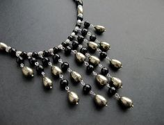 awesome DIY Bijoux - Bib Necklace. Note the bail beads used as spacers.  #Wire #Jewelry #Tutorials...