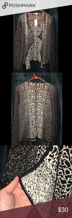 NWT DressBarn animal print sweater Brand New Dress Barn open knit sweater. Black and cream abstract animal print design, with faux leather trim. Dress Barn Sweaters Cardigans