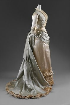 Dinner dress Date: 1877–83 Culture: American Medium: silk, glass Dimensions: Length (a): 21 in. (53.3 cm) Length at CF (b): 43 1/2 in. (110.5 cm) Length (c, d): 10 1/4 in. (26 cm) Credit Line: Gift of Elizabeth Kellogg Ammidon, 1979 Accession Number: 1979.34.2a–d