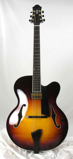Americana AB by Bob Benedetto.  My teacher Cal Collins favorite maker.