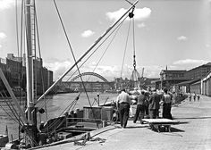 View of men working at the Quayside, Newcastle upon Tyne, June 1961 (TWAM ref. DT.TUR/2/26901B).   Taken by the Newcastle-based photographers Turners Ltd. From the collection of Tyne & Wear Archives