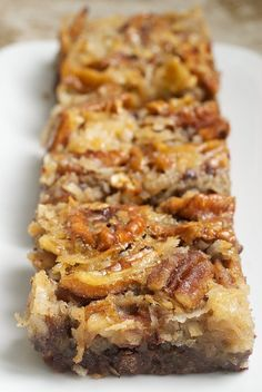 German Chocolate Pecan Pie Bars are a wonderfully delicious combination of chocolate crust, more chocolate, coconut, and pecans. A great crowd pleaser! - Bake or Break
