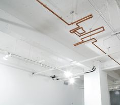 Copper pipe ceiling sculpture