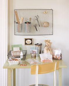 Hang a large, shallow basket over your desk in place of a bulletin board; use S hooks to suspend desk accessories, and clothespins or binder clips to post notes and reminders.