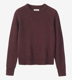 Neatly fitting sweater in a warm, heathery, traditionally spun lambswool. Double rib trim collar. Ribbed cuffs and hem.