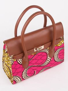 Beautiful handbag with african wax print and leather handle: http://www.africanpremier.com/african-fabric-design-handbag-for-women-with-leather-top-half-bag002-4.html