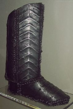 Ottoman Empire steel plate and mail boot,  worn by fully armored cavalryman (sipahi) in conjunction with migfer (helmet), dizcek (cuisse or knee and thigh armor), zirah (mail shirt), kolluk/bazu band (vambrace/arm guards), and kolçak (greaves or shin armor). 16th to 17th century.