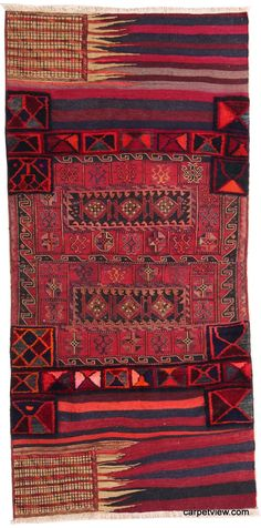 ~ antique Bahtiyar wool rug. This tribal rug was hand-knotted as a saddle bag and has soumak, kilim and carpets on it