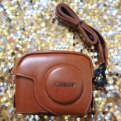 CANON Camera Leather Case  Suitable Model: Canon Powershot G11 G12 Material: Imitation Leather Dimension: 12.6 cm (W) x 9.8 cm (H) x 6.0 cm (D) High quality, compact, lightweight, extremely durable material and easy to carry.  Included leather strap. No need to take out the camera when taking photos!!  *The case is in perfect condition, but my poor girl [camera] died in a water-related incident.  Look at her face.*  SORRY.... I DON'T TRADE  Feel Free to send me an OFFER.  CANON Accessories