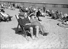 With thoughts of queues, rationing, and workaday worries banished, Mr and Mrs Everyman bask in the Whit-sunshine.