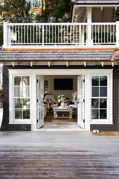 doors and windows again. Muskoka Living ~ LOVE the deck above the room...would have the doors open out to save floor space!