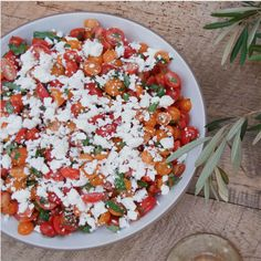 Cherry tomato salad with crumbled goat cheese