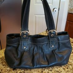 Black Leather Coach Purse Excellent condition with nice silver hardware. Medium to large size. Both ends of purse have snap enlosures to make purse slimmer or wider. Coach Bags Shoulder Bags