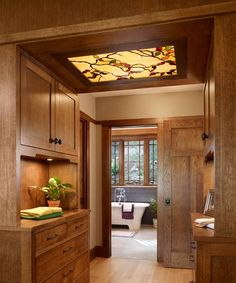 "A stained-glass ""skylight"" (lit by a single LED bulb) brings light and character to a windowless dressing area. 