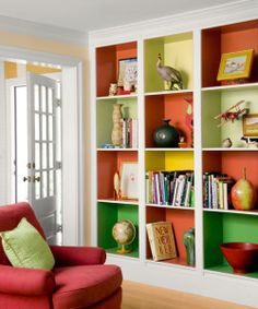 A grid of uniform cubes becomes a playful display case with the help of outspoken colors in a five-way dialogue. Similar to shown: Behr's Sweet Mandarin (orange); Citron (acid green), Dried Palm (pale green), Chickadee (yellow), and Par Four Green (deep green) | Photo: Eric Roth | thisoldhouse.com