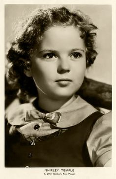:o) Shirley Temple ~ an extremely talented little girl who thrilled the world with her acting, singing & dancing. She was the cutest little thing on the screen in her days at Hollywood, with her bouncing curls, cheeky dimpled face, and melt-your-heart-smile. She danced, sang, & tapped her way into people's hearts. Beautiful child-star.