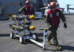 MEDITERRANEAN SEA (Sept. 7, 2016) Marines, from 22nd Marine Expeditionary Unit (MEU), transport AGM-114 Hellfire missiles across flight deck aboard amphibious assault ship USS Wasp (LHD 1) Sept. 7, 2016. 22nd MEU, embarked on Wasp, conducting precision air strikes in support of Libyan Government of National Accord-aligned forces against Daesh targets in Sirte, Libya, as part of Operation Odyssey Lightning. (Mass Comm Spec 2nd Class Nathan Wilkes)