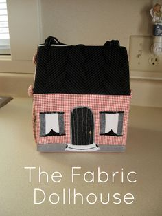 Cris' version of the fabric dollhouse- those would be cute for the shoeboxes. I wonder if they would fit.
