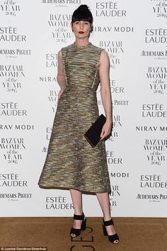 Golden girl:Supermodel Erin O'Connor went for a streamlined look comprising of a stunning mottled A-line gown. The sharp lines of the dress coordinated with her stiff fringe