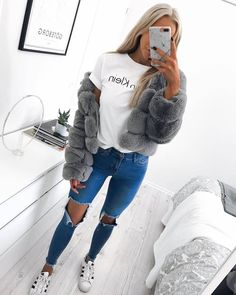 Fluffy faux grey coat with white Calvin Klein printed tee. Ripped blue jeans and white Adidas Superstar sneakers. Cute outfit for school this winter.