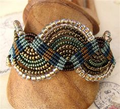 A beaded macrame bracelet in my original design using several colors of seed beads and three different colors of cord.
