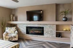 Stunning custom herringbone floors with built-in entertainment center and fireplace with custom painted accent walls.