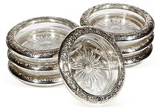 "Vintage (1910-1950) Set of Seven Glass Coasters with Floral Silver Plate Edges.  Marked ""Towle"".  4""Wx0.75""H   $175  SOLD"