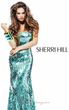 Sherri Hill Prom Dresses 2013 are unmistakably electric and glamorous. Whether you are searching for an elegant evening dress or a short